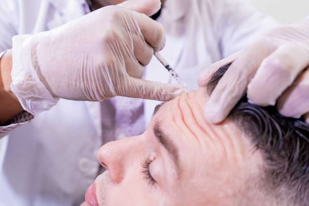 man receiving Botox injections for migraine relief
