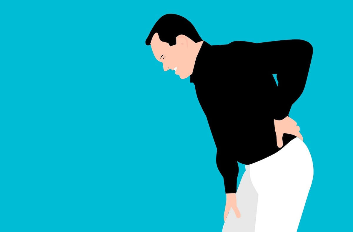 cartoon image of man leaning over with back pain
